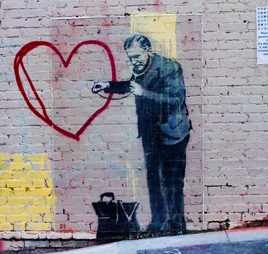 "Image via Flickr Creative Commons. Bansky's ""Peaceful hearts Doctor"" courtesy of Eva Blue."